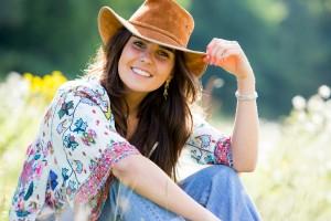 Singer in cowboy hat in the summer sunshine