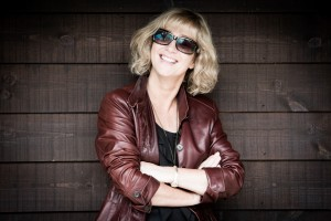 Funky looking lady wearing brown leather jacket and sunglasses