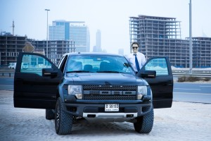 Business man in Dubai at a construction site. Standing outside a Ford 4 x 4