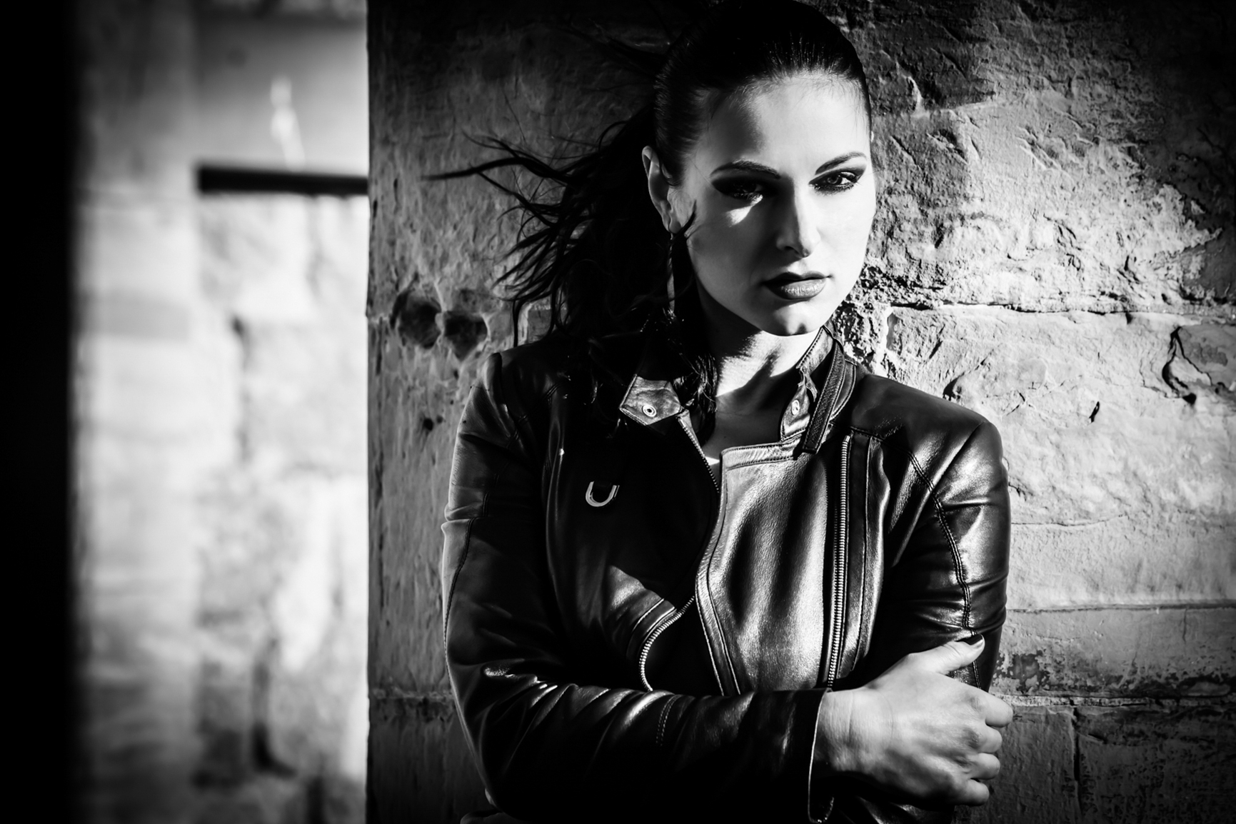 Model in Karen Millen black leather Jacket in strong sunlight