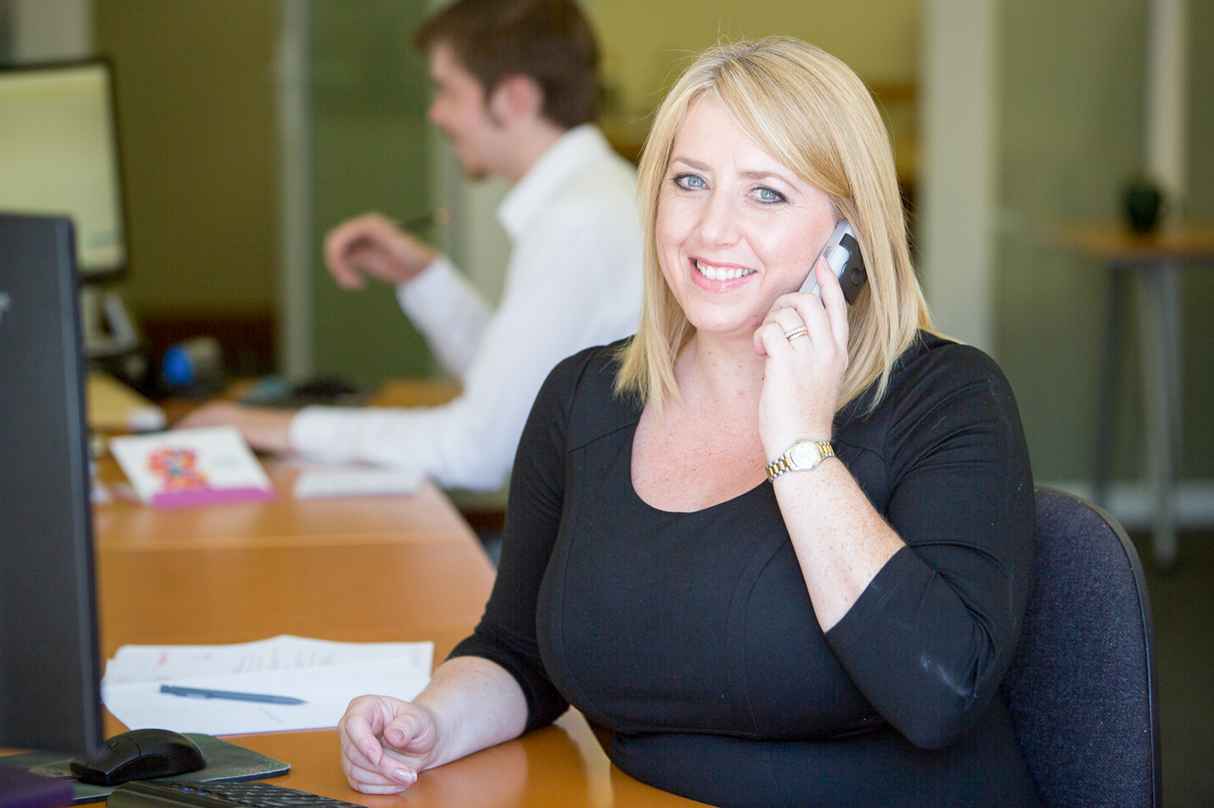 Office lady on the phone for promotional image