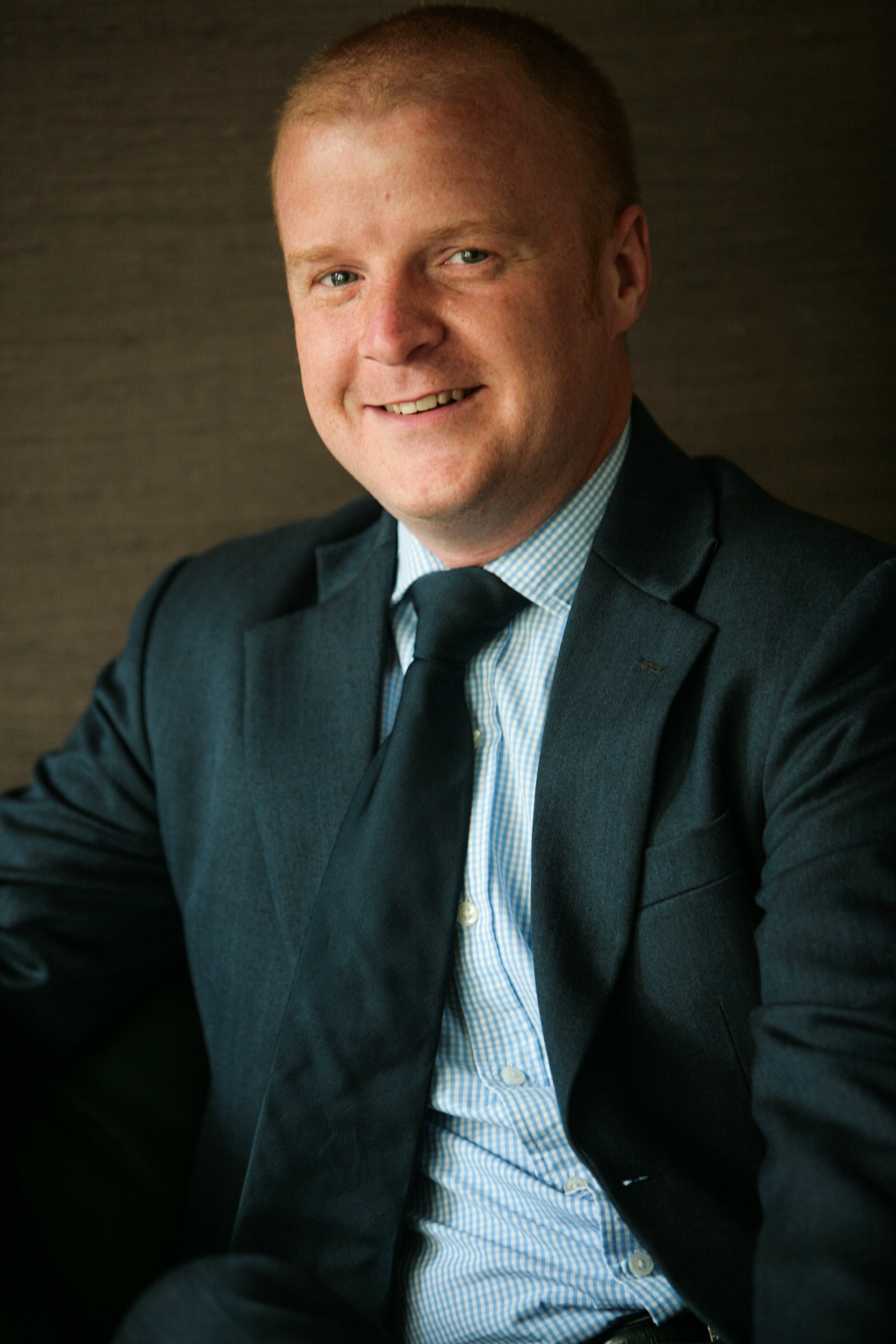 Relaxed headshot of businessman from corporate web site campaign