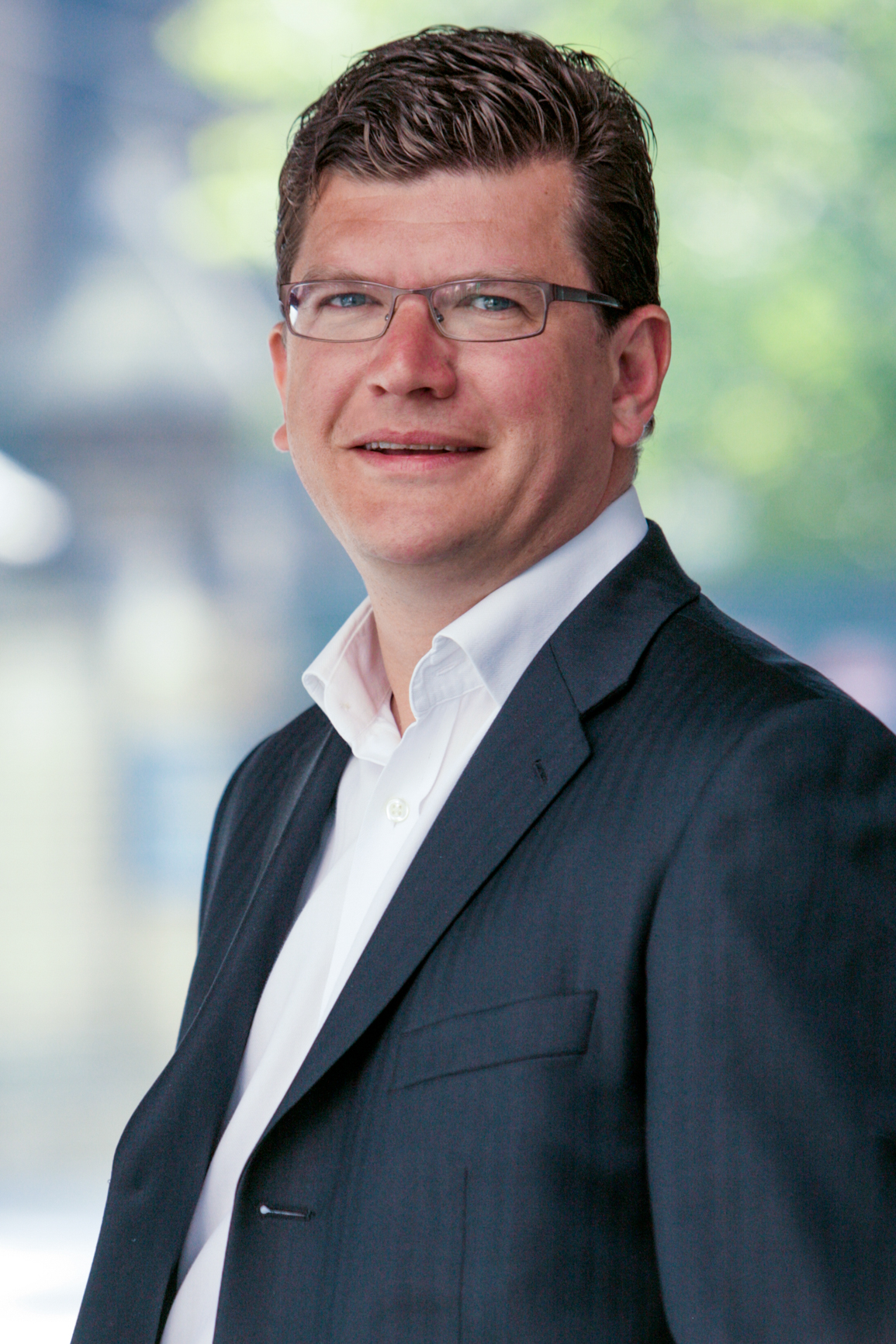 Headshot of businessman in the city of London for corporate web site