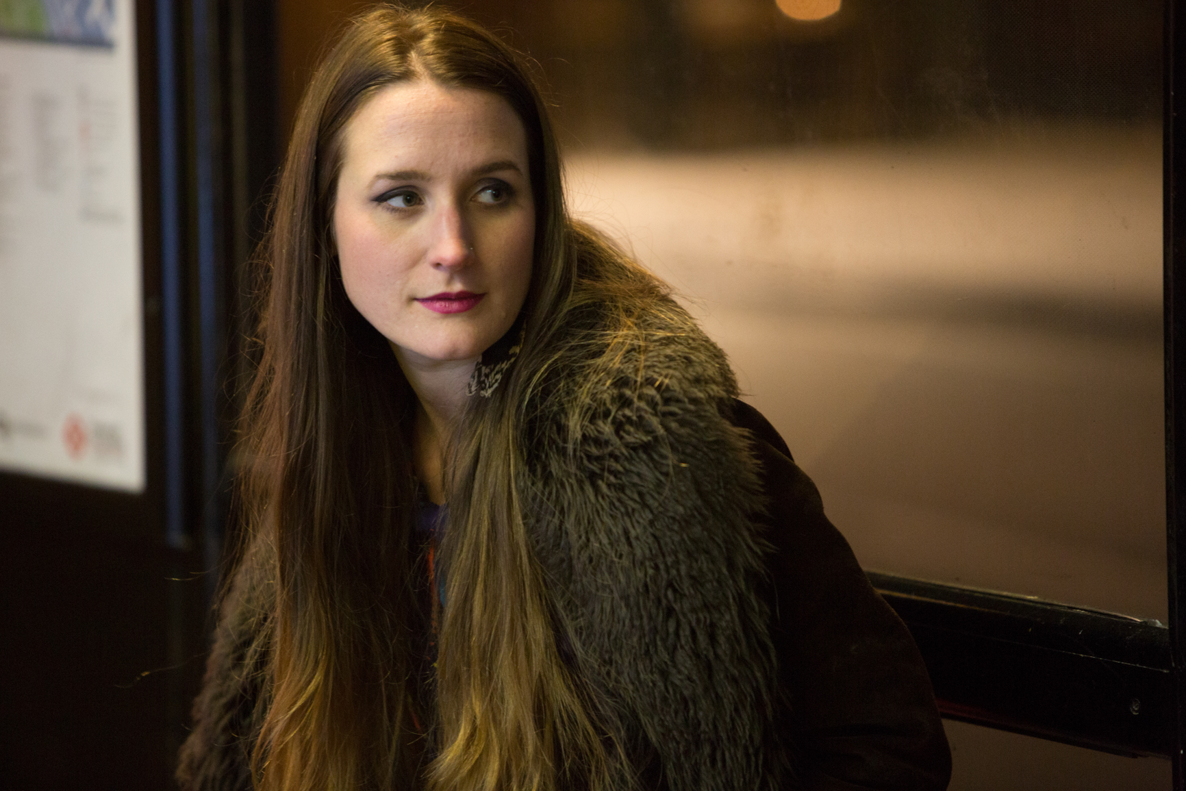 Holly Holden, London Singer at night in chelsea by bus stop